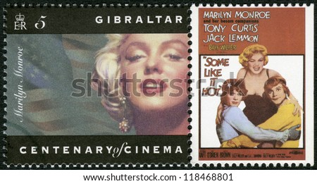"GIBRALTAR - CIRCA 1995: A stamp printed in Gibraltar shows Marilyn Monroe, Tony Curtis, Jack Lemmon, ""Some Like It Hot"", circa 1995 - stock photo"