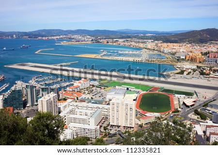 Gibraltar city and airport runway and La Linea de la Concepcion in Spain. - stock photo