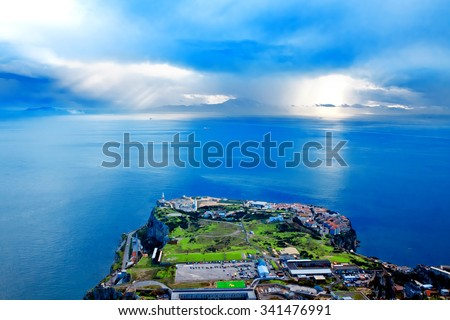 Gibraltar. Gibraltar is a British territory located to south of Iberian Peninsula at entrance to Mediterranean Sea. The land is one of most southerly points in Europe - stock photo