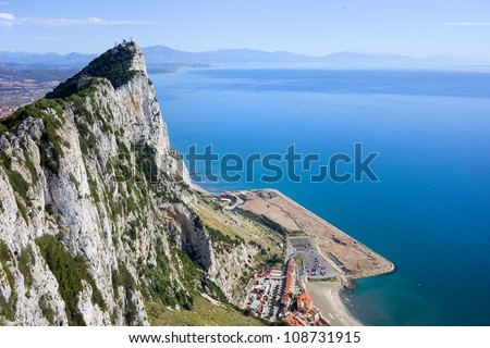 Gibraltar Rock steep cliff by the Mediterranean Sea in southern part of Iberian Peninsula. - stock photo