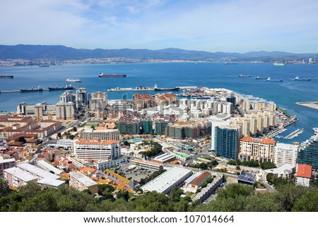 Gibraltar town urban scenery and Gibraltar Bay on southern part of Iberian Peninsula, Spain on the horizon.
