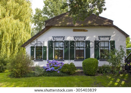 GIETHOORN, NETHERLANDS -typical dutch county side of houses and gardens - stock photo