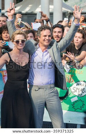 GIFFONI VALLE PIANA (SA) - JULY 18: Actor Mark Ruffalo and wife Sunrise Coigney and Claudio Gubitosi poses at blue carpet during the 45th Giffoni Film Festival, July 18, 2015 in Salerno, Italy. - stock photo