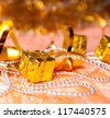 gift,a star,Christmas beads,serpentine on the yellow - stock photo
