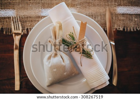 gift and cloth lay on a plate with cutlery - stock photo