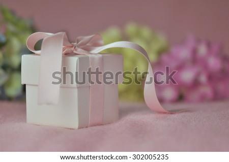 Gift and Hydrangeas - stock photo