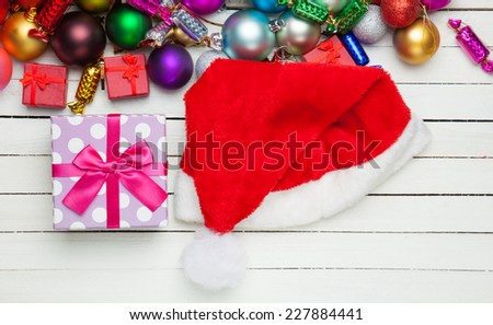 Gift and Santa's hat near toys