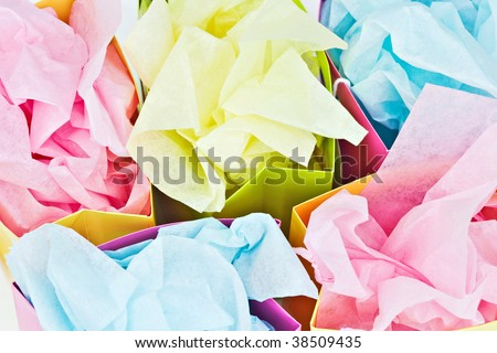 Gift bags with tissue paper - stock photo