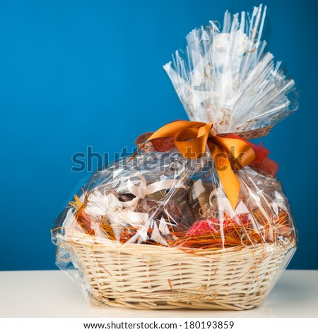 gift basket against blue background - stock photo