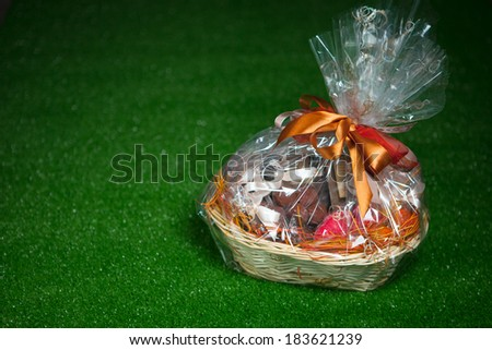 gift basket against green lawn background - stock photo