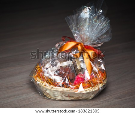 gift basket against wooden background - stock photo