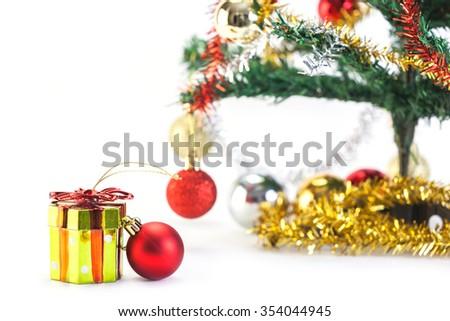 Gift box and christmas decoration isolated on white background - stock photo