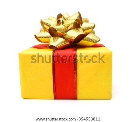 Gift box and gold bow on white background