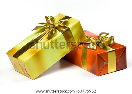 Gift box and golden ribbon, isolated on the white background - stock photo