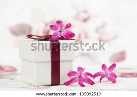 Gift box and little pink hyacinth flowers. Shallow dof - stock photo