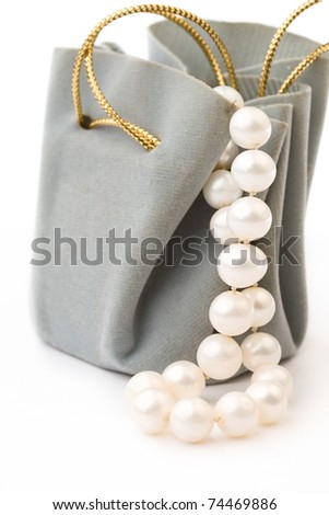 Gift box and pearl isolated on white - stock photo