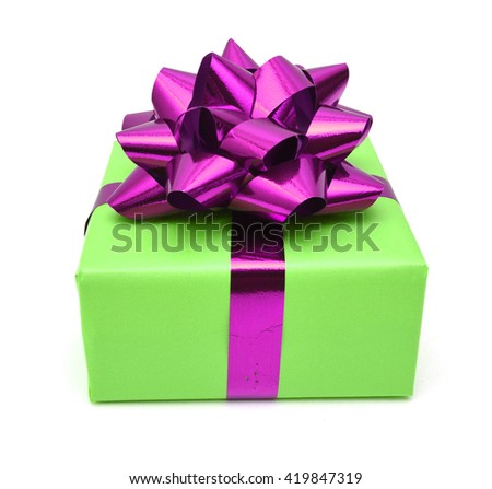 Gift box and pink bow on white background  - stock photo