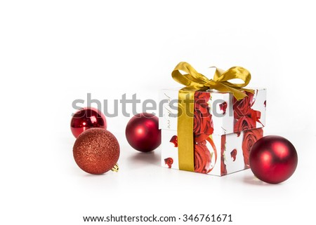 gift box and red Christmas balls on a white background