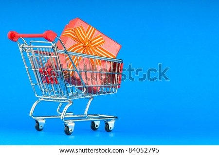 Gift box and shopping cart - stock photo