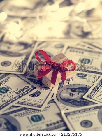 Gift box and US dollar bills. Toned picture - stock photo