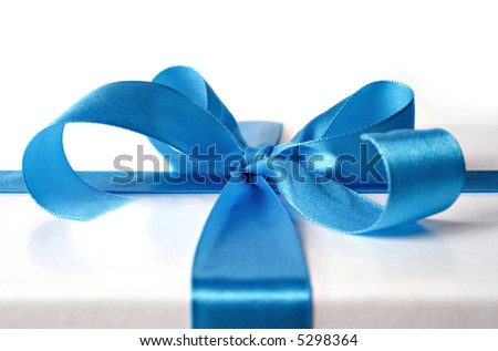 gift box. blue ribbon, to wrap around every present you like - stock photo