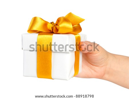 gift box in hand with ribbon isolated on white