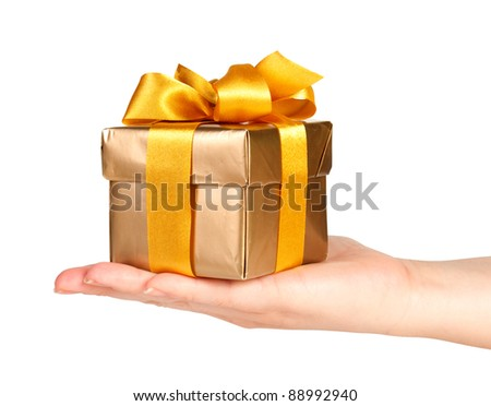 gift box in hand with ribbon isolated on white - stock photo