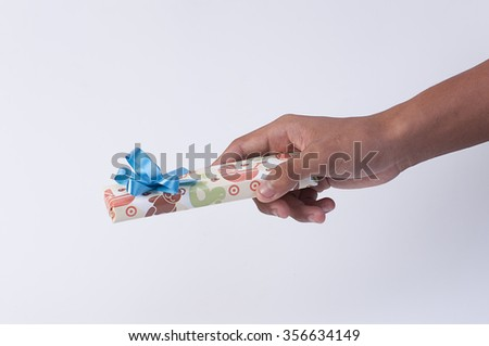 Gift box in hands on a white background