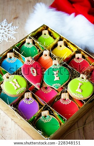 Gift box of Christmas ornament cookies - stock photo