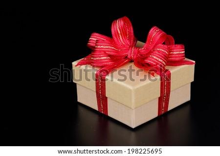 Gift box on black background - stock photo
