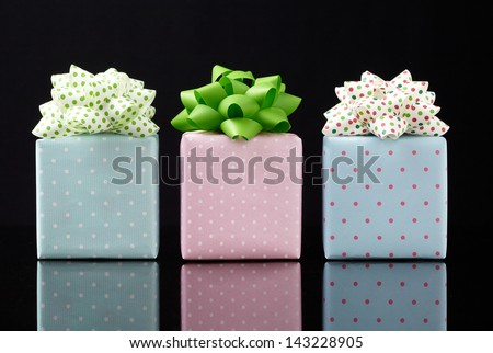 gift box on black background.  Group of presents. Gift boxes with origami bows.  - stock photo
