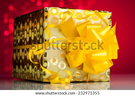 Gift box  on sparkles background - stock photo