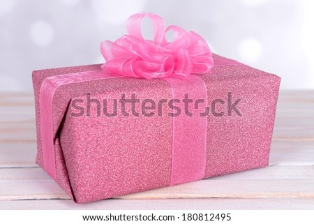 Gift box on table on light background