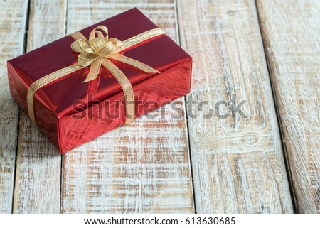 Gift box on the old wooden table.