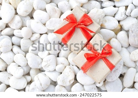 gift box on white stone background  - stock photo