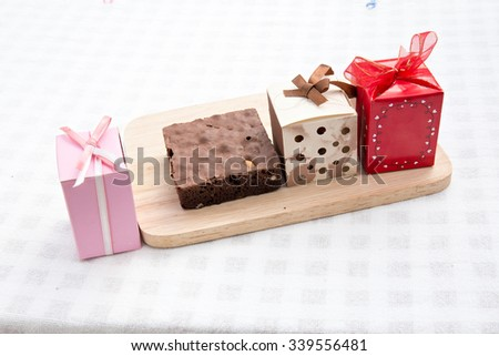 gift box on wooden and cake