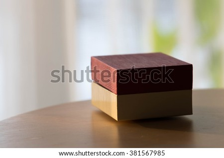 gift box on wooden table on light background - stock photo