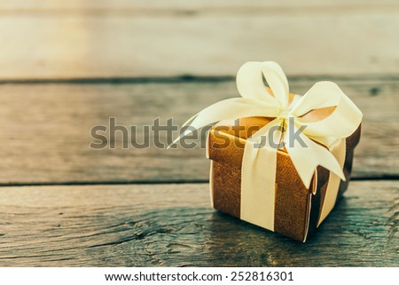 Gift box on wooden table - Vintage effect style pictures