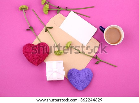 gift box (package) with blank gift tag on pink background with coffee, flowers and handmade heart. - stock photo