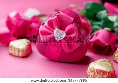 Gift box, Pink roses and candy. Valentines Day background, wedding day. Shallow DOF - stock photo