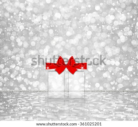 gift box red bow on white silver glitter bokeh abstract background