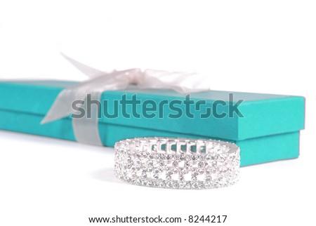 Gift Box, Ribbon, and Beautiful Bracelet - stock photo