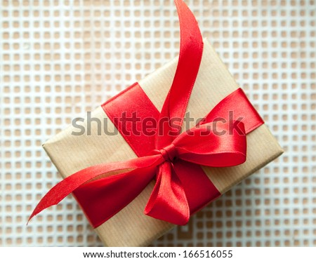 gift box tied with a red ribbon on the table