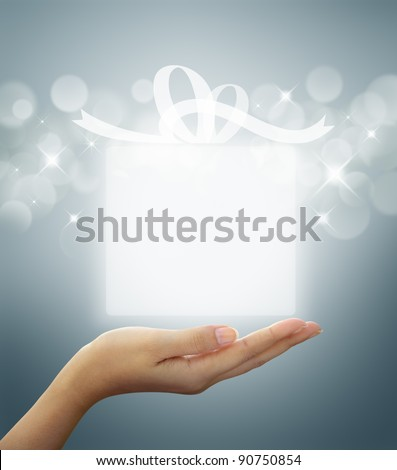 gift box Translucent white on woman hand - stock photo