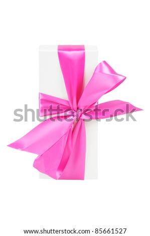 Gift box with a big pink bow. Isolated on white.