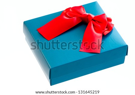 Gift box with a red ribbon bow isolated on white background.