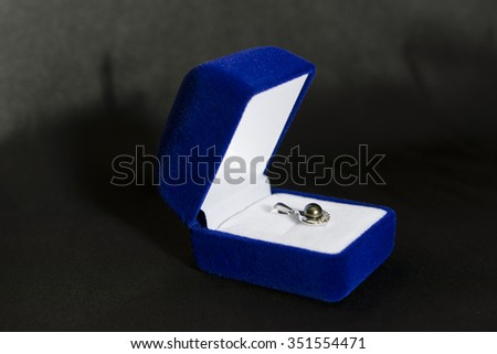 gift box with black pearl pendant - stock photo