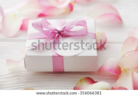 gift box with blank gift tag. pink satin gift bow - stock photo