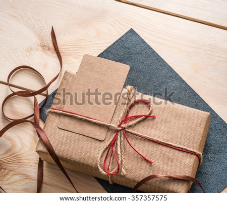 Gift box with blank tag. - stock photo
