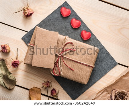 Gift box with blank tag and hearts. Top view. - stock photo